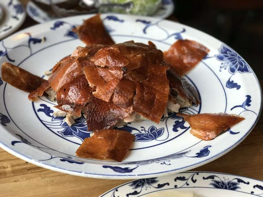 The peking duck from Great China in Berkeley. Click on the slideshow ahead to see what restaurants local chefs take their out of town guests >>>