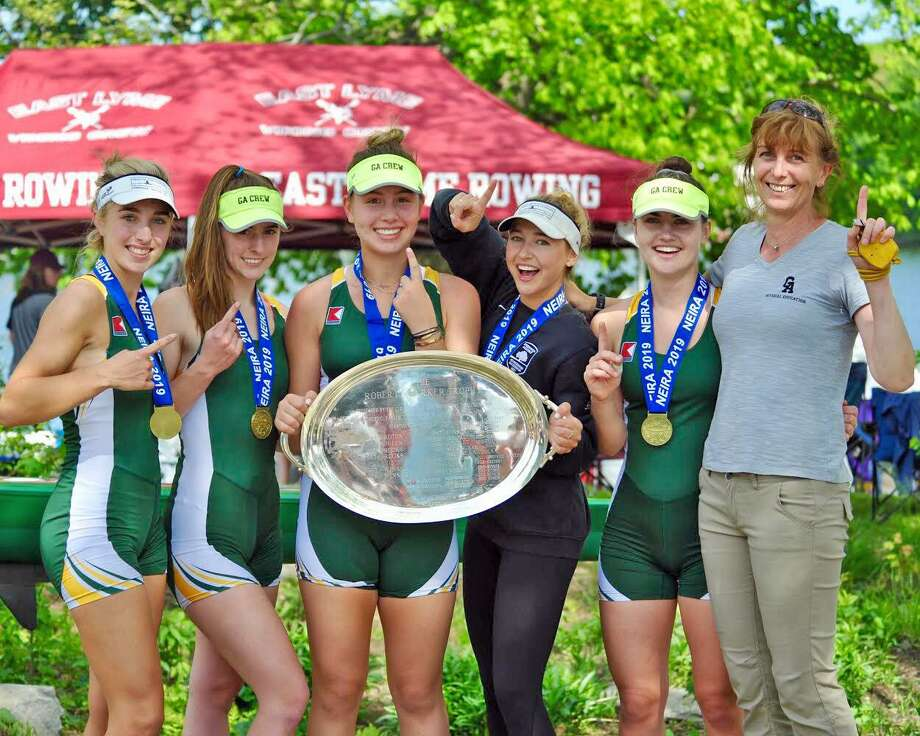 "Greenwich Academy's second varsity four boat captured the first-place medal in the Grand Final at the New England Interscholastic Rowing Association Championships recently in Worcester, Mass. The crew included, pictured left to right, Brooke Lange, Madison Farello, Isabelle Stemerman, Lilly Brooks and Maia van Biesen. Coach Stani Slavova is pictured at the far right. Lange, Farello, Stemerman, Lilly Brooks and van Biesen won the race in 6:12 and finished ahead of crews from Noble and Greenough School, Deerfield Academy, Groton School, Choate Rosemary Hall, Brooks Academy and Buckingham Browne & Nichols in the championship race. Greenwich Academy's first varsity four boat of Marie Brewer, Schuyler Hyde, Caroline Schmitz, Charlotte Sorbaro and Isabel Allard placed sixth in the Grand Final at the NEIRA Championships. ""The great results achieved by our student-athletes are a testimony of their hard work, discipline and dedication to the high standards they set in everything they do,"" Slavova said. ""Those achievements were made possible, because of the consistent support of parents, teachers and the GA athletic department."" Photo: Contributed Photo / Greenwich Time Contributed"