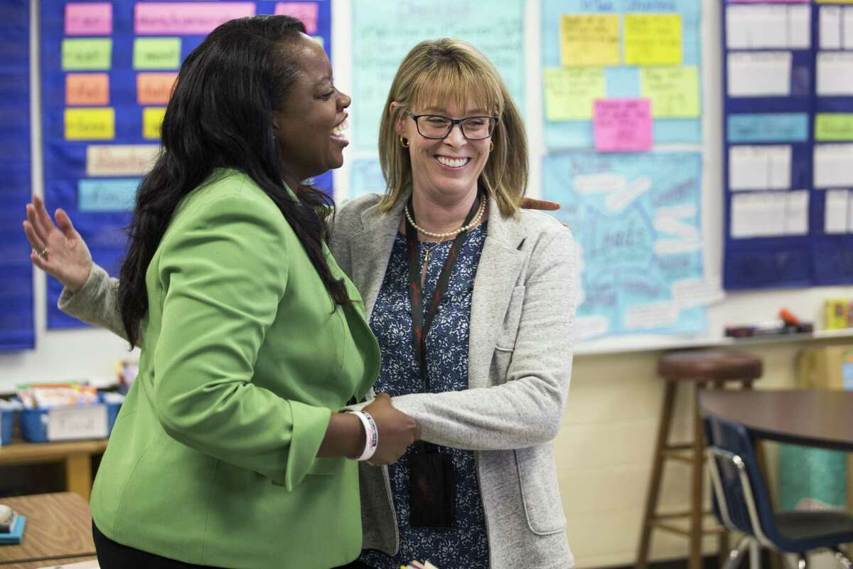 Dr. LaTonya Goffney, Aldine ISD superintendent, left, greets third grade teacher Rachel Velotas while visiting Goodman Elementary School on Tuesday, April 23, 2019, in Houston.