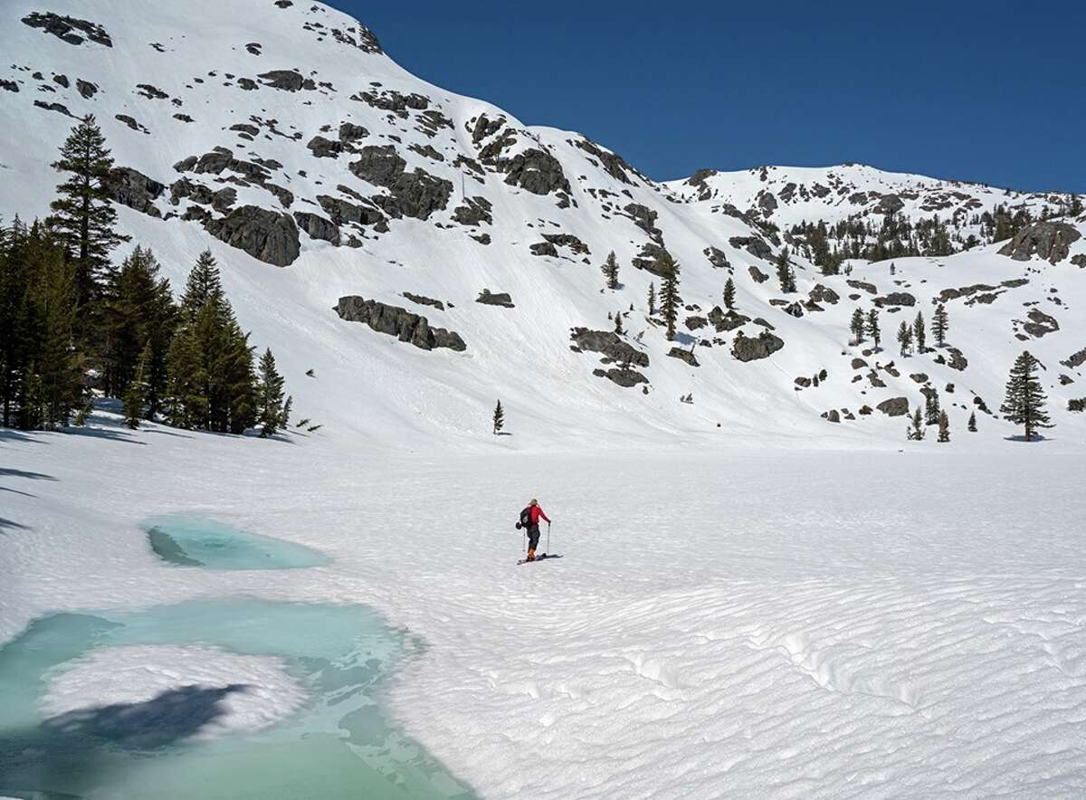 A person skis across a frozen Fourth of July Lake near Kirkwood, Calif., in May 2019.