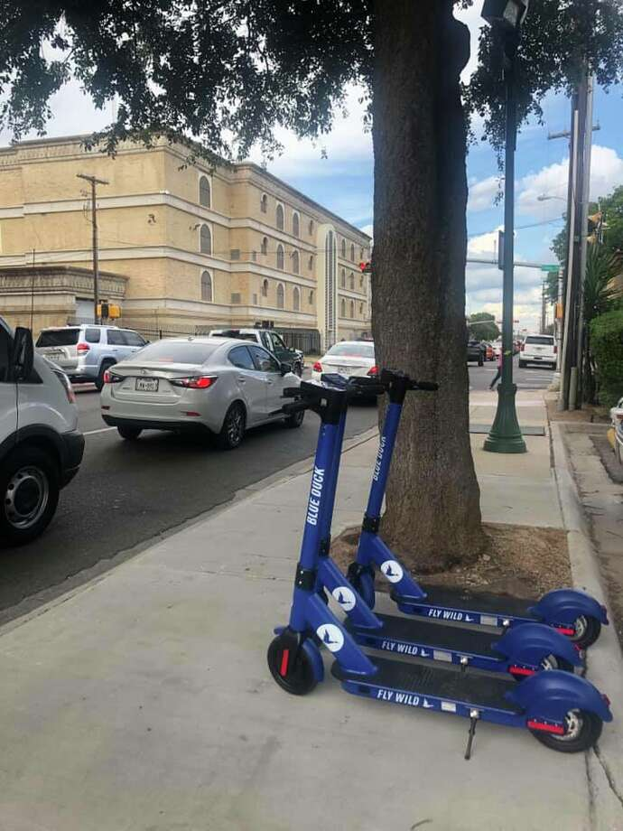 In this courtesy photo obtained from the Streets of Laredo facebook page, Blue Duck scooters are shown parked on the streets of downtown Laredo. Photo: Facebook.com