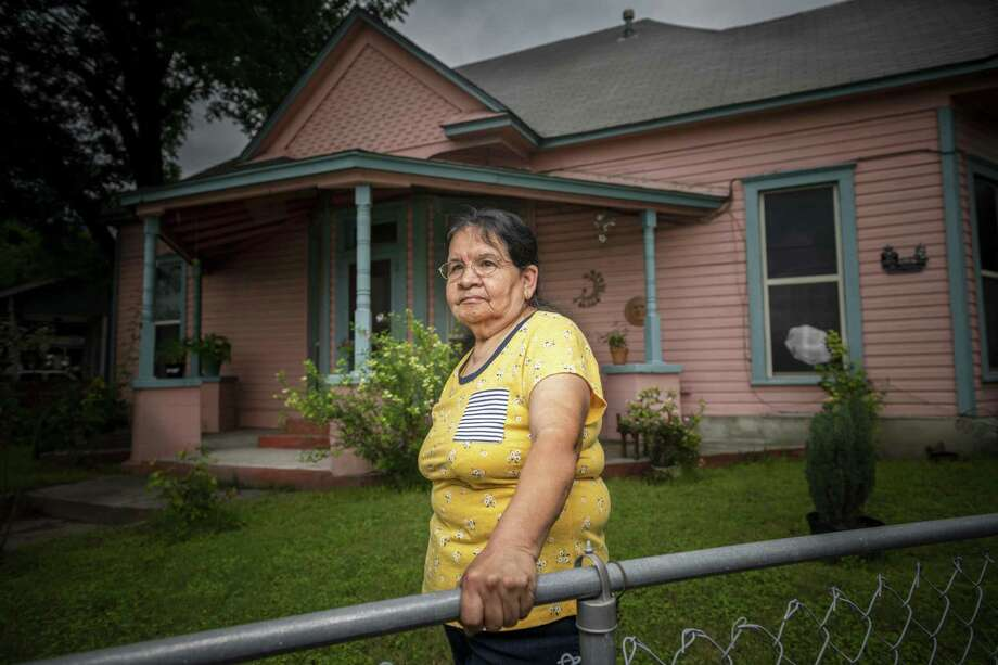 Longtime West Euclid Avenue homeowner Virginia Guerra gets numerous calls to buy her home but has no intention of selling. Photo: Carlos Javier Sanchez / Carlos Javier Sanchez