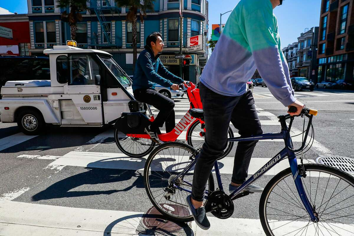 Bikers ride past 6th and Howard Streets where a cyclist was killed last Friday after being struck by a vehicle in San Francisco, California, on Monday, March 11, 2019