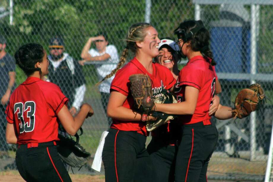 Masuk celebrate its win over North Haven during Class L softball action in Stratford, Conn., on Tuesday June 4, 2019. Photo: Christian Abraham / Hearst Connecticut Media / Connecticut Post
