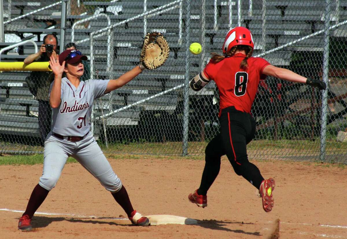 Masuk's Gretchen Bunovsky (8) reaches first as North Haven's Eryn Sheeley (31) attempt tp make the tag during Class L softball action in Stratford, Conn., on Tuesday June 4, 2019. Sheeley missed the throw to her allowing Bunovsky to be called safe.