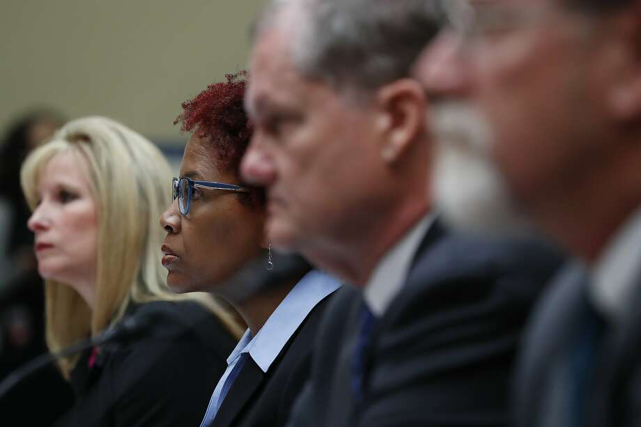 From left, Kimberly Del Greco, FBI Deputy Assistant Director of Criminal Justice Information Services, Gretta Goodwin, Director of Homeland Security and Justice for the Government Accountability Office, Charles Romine, Director of the Information Technology Laboratory at the National Institute of Standards and Technology, and Austin Gould, Assistant Administrator of Requirements and Capabilities Analysis at the Transportation Security Administration (TSA), attend a House Oversight and Reform committee hearing on facial recognition technology in government, Tuesday June 4, 2019, on Capitol Hill in Washington. (AP Photo/Jacquelyn Martin) Photo: Jacquelyn Martin, Associated Press