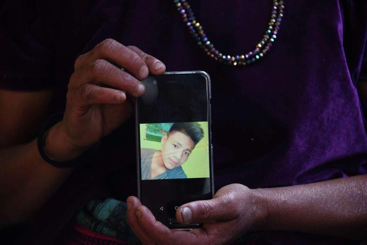 Rigoberta Vasquez, mother of 16-year-old migrant Carlos Hernandez Vasquez, shows a photo of her son, who died in border-patrol custody.