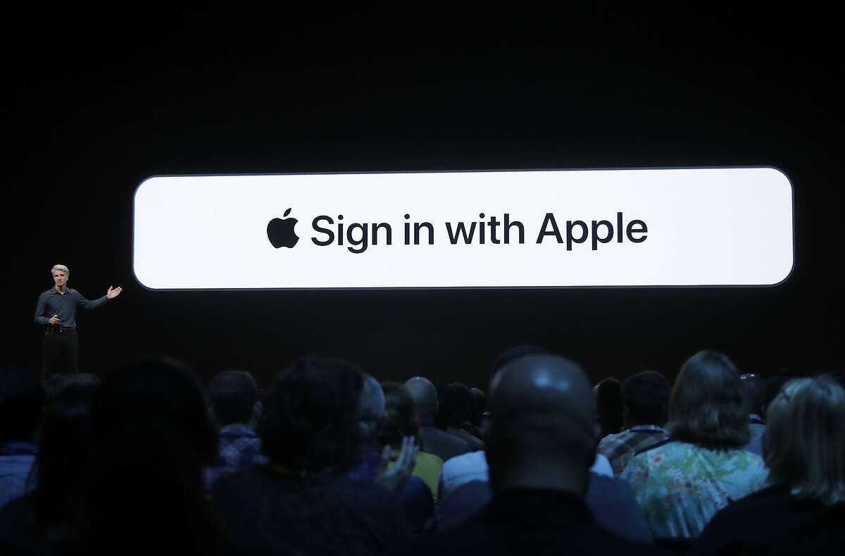 Craig Federighi, Apple's senior vice president of Software Engineering, speaks about the Sign in with Apple feature at the Apple Worldwide Developers Conference in San Jose, Calif., Monday, June 3, 2019. (AP Photo/Jeff Chiu)