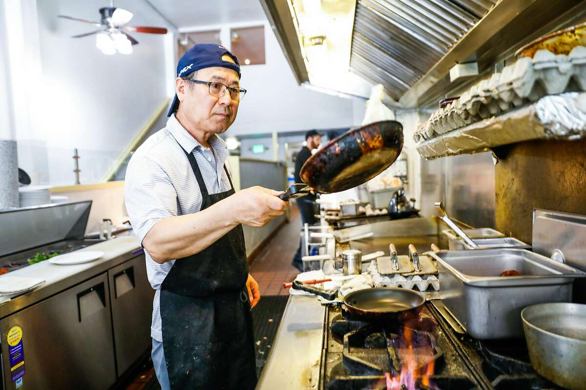 Cook Paul Chung flips eggs as he prepares an order during lunchtime at Delegates restaurant in Oakland, California, on Tuesday, June 4, 2019.