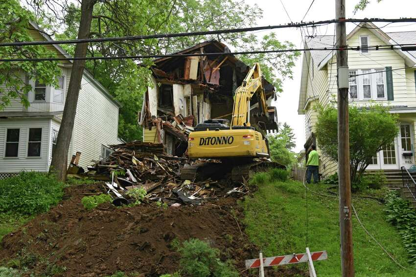 A house at 865 Myrtle Ave. is demolished after being deemed an unsafe structure on Tuesday, June 4, 2019 in Albany, N.Y. Parts of the floor had collapsed into the basement before the demolition crew showed up. (Lori Van Buren/Times Union)