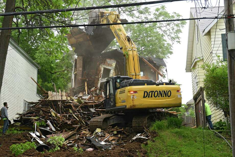 A house at 865 Myrtle Ave. is demolished after being deemed an unsafe structure on Tuesday, June 4, 2019 in Albany, N.Y. Parts of the floor had collapsed into the basement before the demolition crew showed up. (Lori Van Buren/Times Union) Photo: Lori Van Buren, Albany Times Union