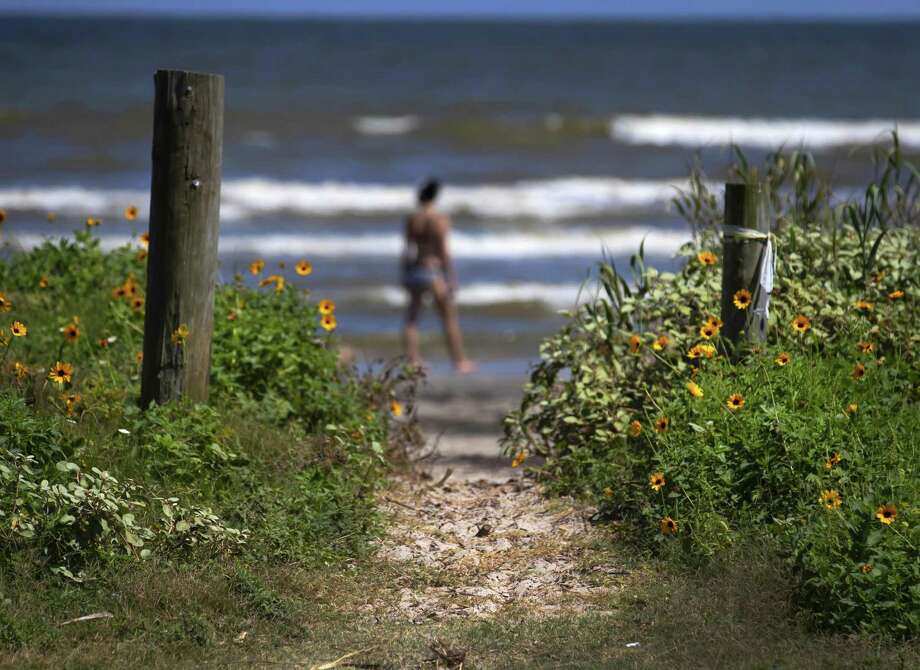 In this June 3, 2019, photo LA narrow pathway leads down to the beach at an access point on Maison Rouge in the Pirates Beach community Galveston's west end. (Stuart Villanueva/The Galveston County Daily News via AP) Photo: Stuart Villanueva / Stuart Villanueva / Associated Press / © 2019 Stuart Villanueva/The Galveston County Daily News
