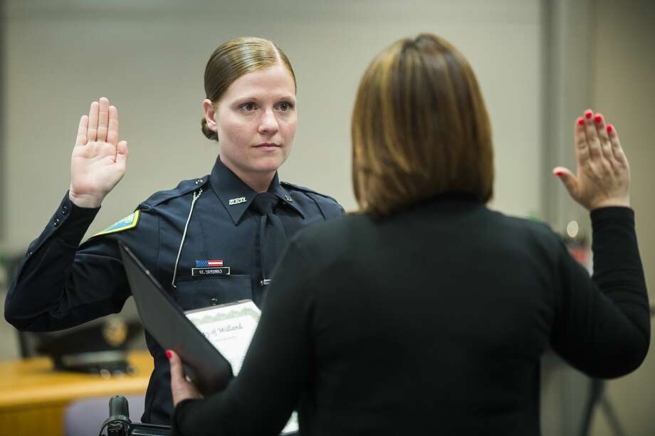 Officer Katerina Sequin of the Midland Police Department is sworn in by City Clerk Selina Tisdale during a ceremony on Tuesday, June 4, 2019 at City Hall. (Katy Kildee/kkildee@mdn.net) Photo: (Katy Kildee/kkildee@mdn.net)