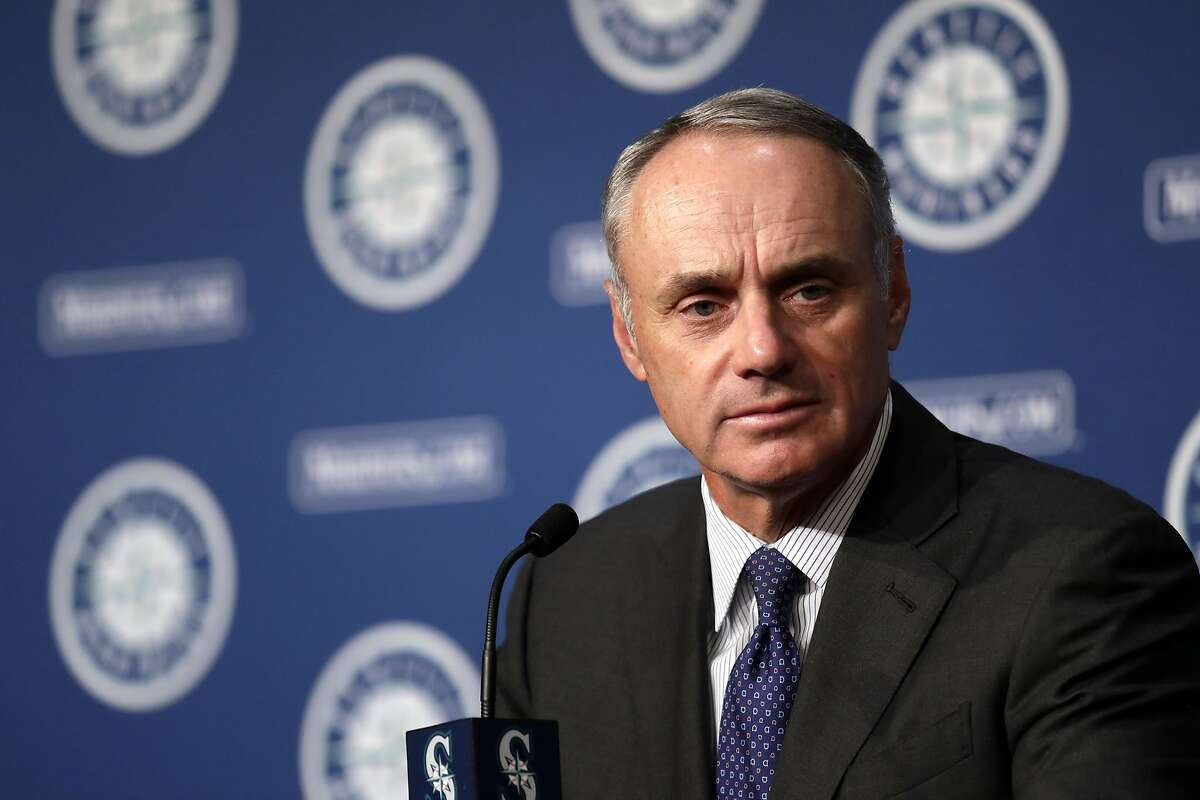 Rob Manfred, Commissioner of Baseball, addresses media members before a baseball game between the Seattle Mariners and Houston Astros Tuesday, June 4, 2019, in Seattle. (AP Photo/Elaine Thompson)