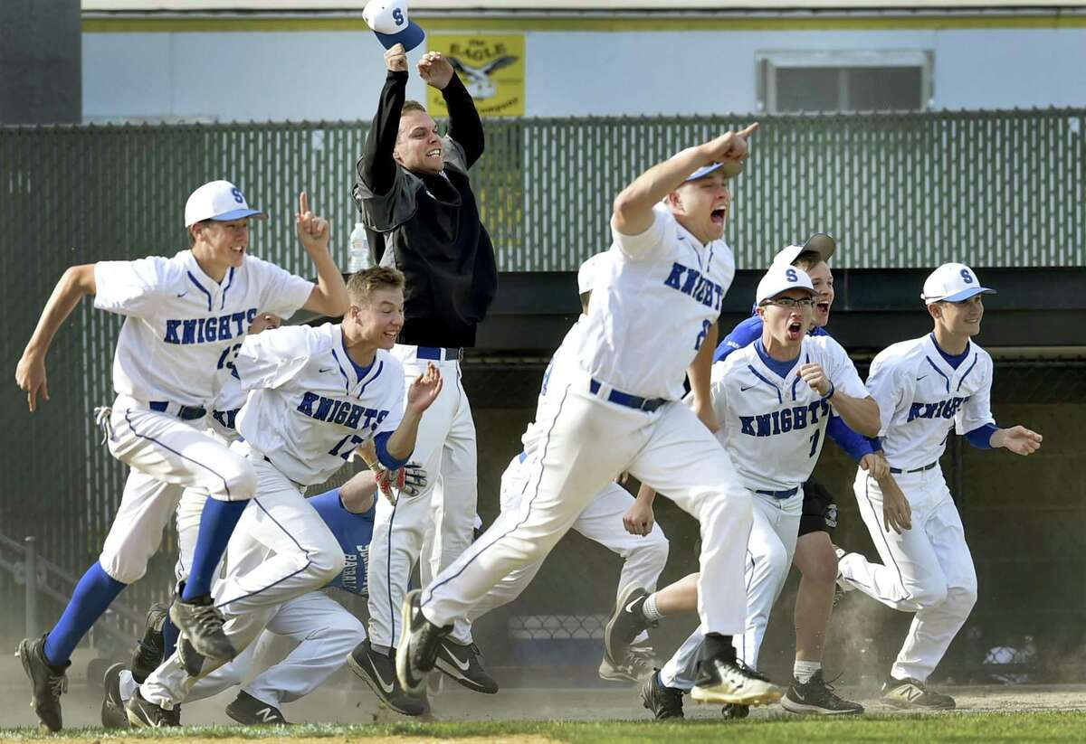 Waterbury, Connecticut - Tuesday, June 3, 2019: Southington H.S. rushes the field and celebrates after Jake Neuman of Southington H.S. gets a seventh inning 2-out walk off hit that scored that scored the winning run during the CIAC Class LL 2019 State Baseball Tournament Semifinals Tuesday at the Municipal Stadium in Waterbury. Southington H.S. defeated Amity H.S. 3-2.