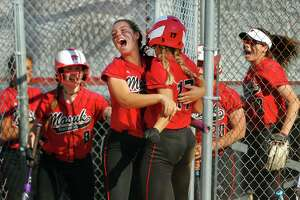 Masuk celebrates during Class L softball action against North Haven in Stratford.