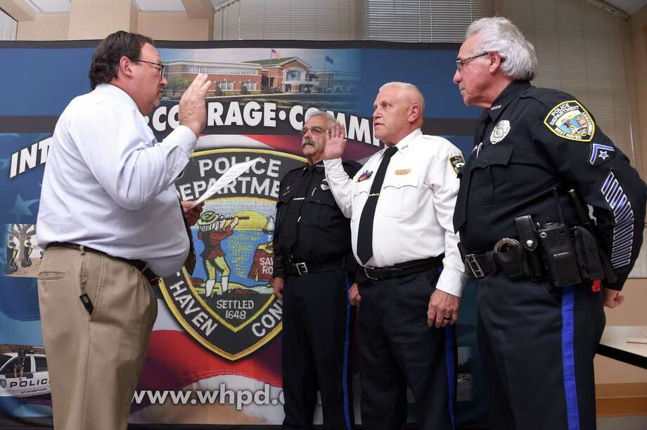 West Haven Police Commissioner Peter BonTempo, left, swears in Joseph Perno, second from right, as the new West Haven police chief at the West Haven Police Department on Tuesday. Flanking Perno are Master Patrol Officers Vincent Costanzo, center, and Louis Matteo, right. Photo: Arnold Gold / Hearst Connecticut Media / New Haven Register