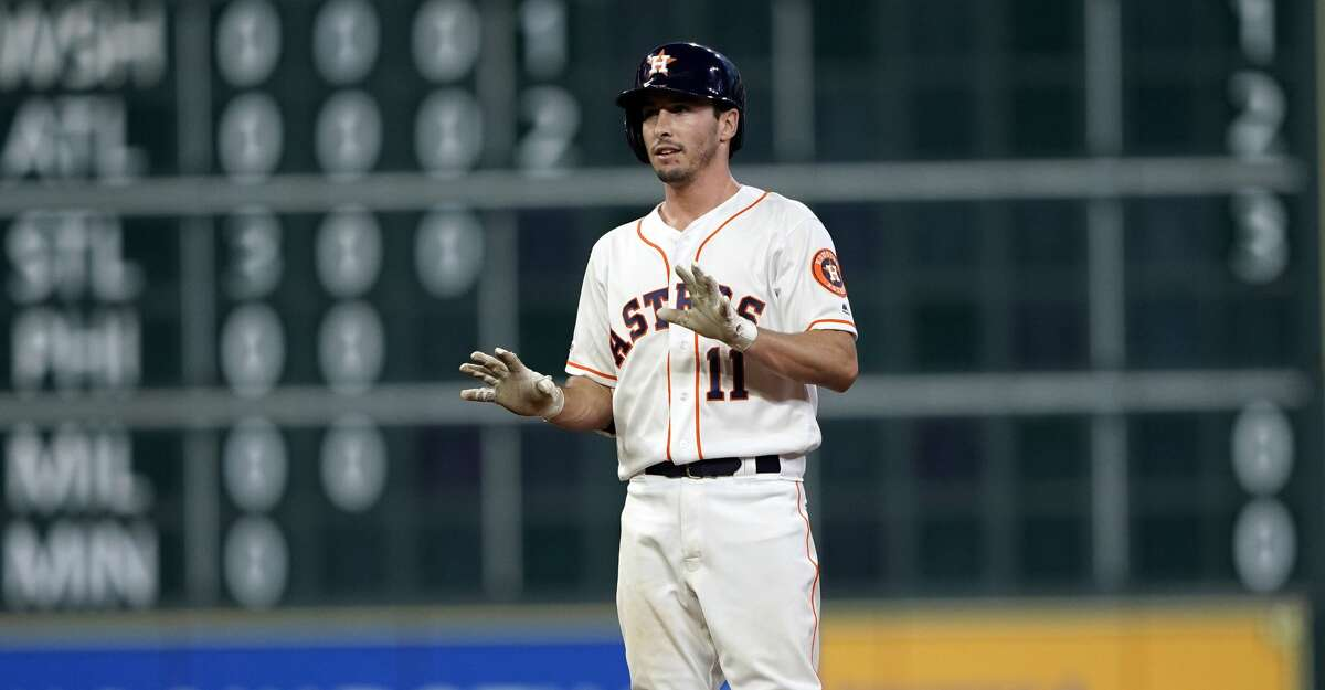 Houston Astros' Garrett Stubbs reacts after hitting a double against the Chicago Cubs during the second inning of a baseball game Tuesday, May 28, 2019, in Houston. It was Stubbs first major league hit.(AP Photo/David J. Phillip)