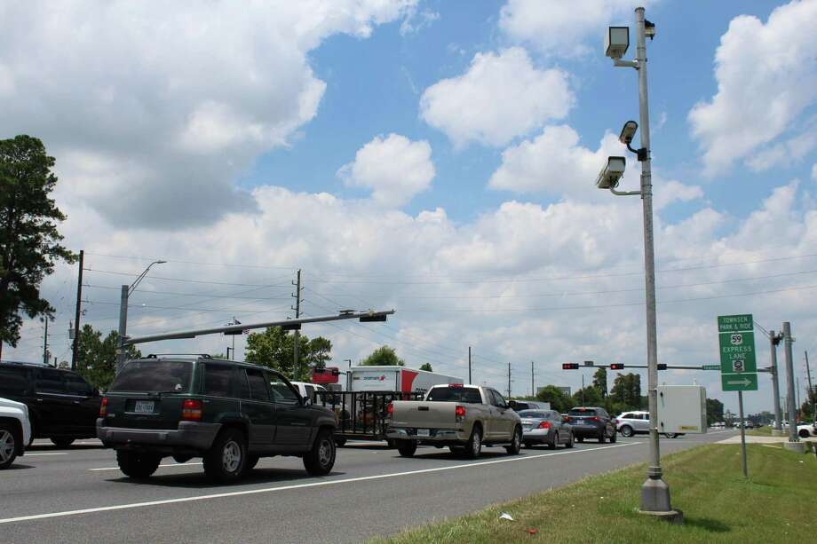 A red light camera monitors traffic at Townsen Boulevard and the FM 1960 Bypass in Humble. The City of Humble currently has 10 red light cameras in place, all still operational despite a state ban. Photo: Kaila Contreras