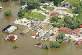 Downtown Grafton, including the intersection of Illinois Routes 3 and 100, left, were under water Tuesday as the village continues to battle the flooding with their own flood wall built near village hall. Additional aerial flooding photos from around the area on page C-1. More photos in the Thursday edition of the The Telegraph and Thursday at www.thetelegraph.com. Downtown Grafton, including the intersection of Illinois Routes 3 and 100, left, were under water Tuesday as the village continues to battle the flooding with their own flood wall built near village hall. Additional aerial flooding photos from around the area on page C-1.