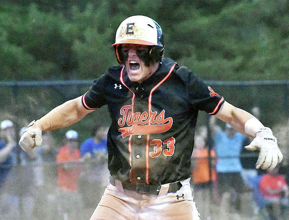 Edwardsville first baseman Drake Westcott celebrates after scoring the go-ahead run in the seventh inning against Marist on Monday in Springfield. Photo: Matt Kamp | For The Telegraph