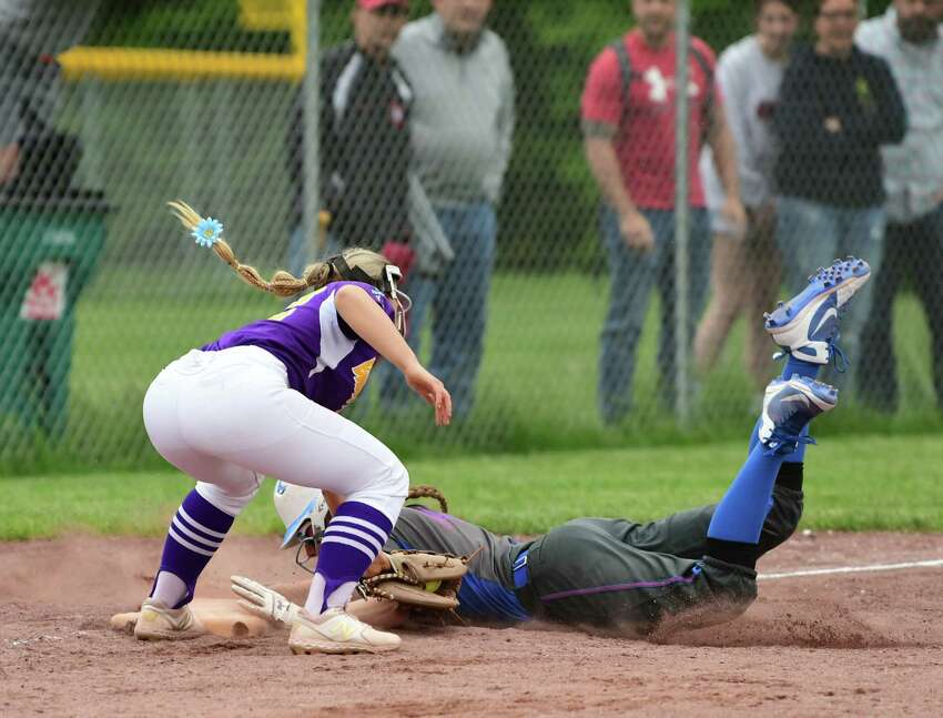 South Glens Falls Zoe Lanfear is safe under Ballston Spa third baseman Paige Davis's tag during the Class A softball final at the Luther Forest Complex on Tuesday, June 4, 2019 in Malta, N.Y. (Lori Van Buren/Times Union)