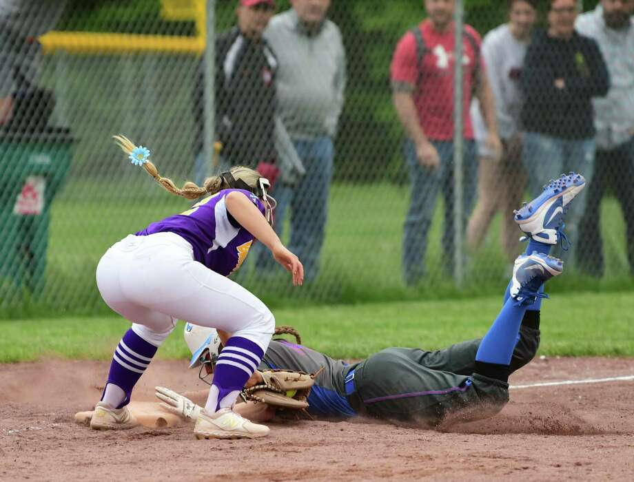 South Glens Falls Zoe Lanfear is safe under Ballston Spa third baseman Paige Davis's tag during the Class A softball final at the Luther Forest Complex on Tuesday, June 4, 2019 in Malta, N.Y. (Lori Van Buren/Times Union) Photo: Lori Van Buren / 40047097A