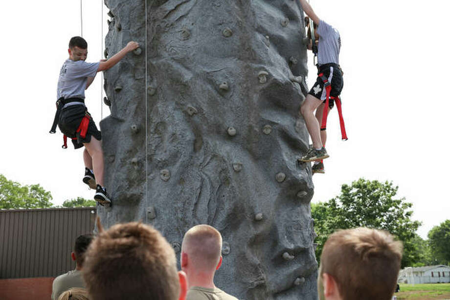 The Illinois National Guard brought a portable climbing wall for the Youth Academy to climb. Illinois National Guard Staff Sgt. Mark Vanbibber instructs the Youth Academy attendees on how to go about their next adventure — rock climbing. Photo: Breanna Booker | The Intelligencer