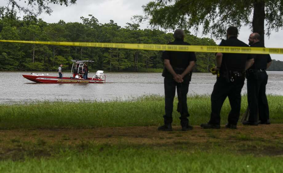 Emergency personnel, including a dive team, search in the Neches River off of Collier's Ferry Park Tuesday evening into the night looking for the body of 50-year-old man. Photo taken on Tuesday, 06/04/19. Ryan Welch/The Enterprise Photo: Ryan Welch/The Enterprise