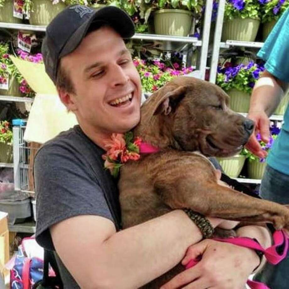 Adam Rohde of Saginaw said he was allergic to dogs growing up but he eventually grew out of it. Now, he volunteers his time at the Saginaw County shelter. (Photo provided)