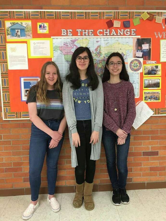 Pictured from left to right are Jefferson Middle School students Alexandra Little, 13, Juliana Vargas, 13, and Anabelle Wilken, 14.Aspart of the Culture Club, the girls applied for and won a $2,000 grantto help update the school's recycling system.