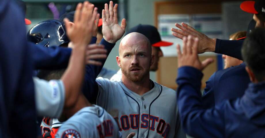 SEATTLE, WASHINGTON - JUNE 04:  Derek Fisher #21 celebrates after scoring off a double hit by Alex Bregman #2 of the Houston Astros in the fifth inning against the Seattle Mariners during their game at T-Mobile Park on June 04, 2019 in Seattle, Washington. (Photo by Abbie Parr/Getty Images) Photo: Abbie Parr/Getty Images