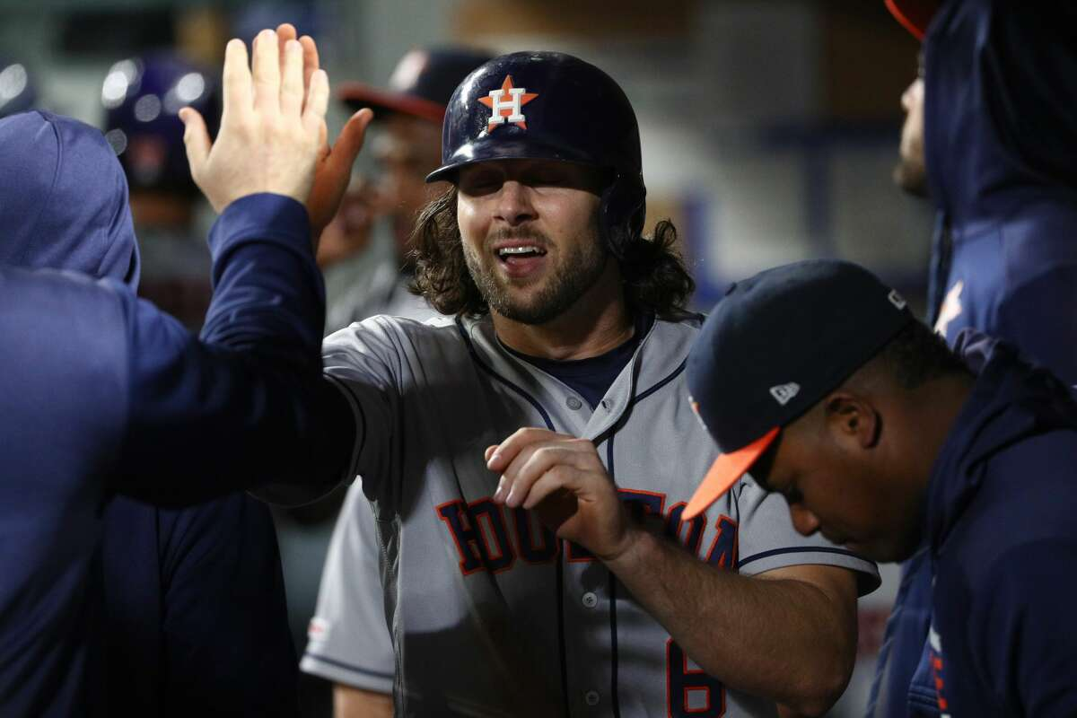SEATTLE, WASHINGTON - JUNE 04: Jake Marisnick #6 celebrates in the dugout after scoring to go-ahead run in the seventh inning off a groundout by Alex Bregman #2 of the Houston Astros against the Seattle Mariners during their game at T-Mobile Park on June 04, 2019 in Seattle, Washington. (Photo by Abbie Parr/Getty Images)