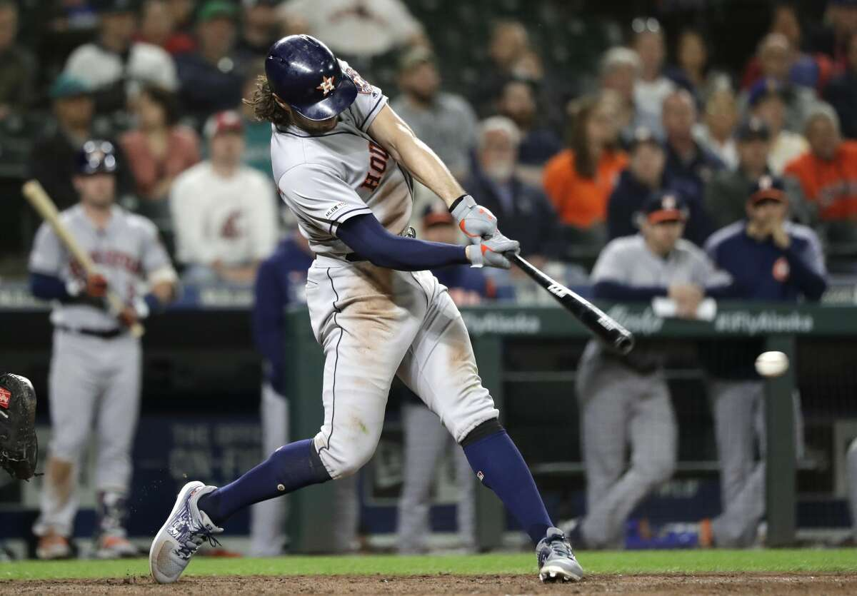 Houston Astros' Jake Marisnick doubles in a pair of runs against the Seattle Mariners in the eighth inning of a baseball game Tuesday, June 4, 2019, in Seattle. (AP Photo/Elaine Thompson)