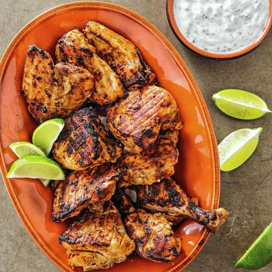 A tandoor oven is not readily found in most American kitchens, but this recipe for Tandoori Chicken with Raita doesn't require one. Photo: Joe Keller | America's Test Kitchen Via AP