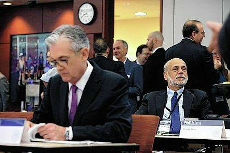 Former Federal Reserve Chairman Ben Bernanke (right) sits Tuesday in Chicago as Federal Reserve Chairman Jerome Powell prepares his speech at a conference involving the Fed's review of its interest-rate policy strategy and communications. Photo: Kiichiro Sato | AP