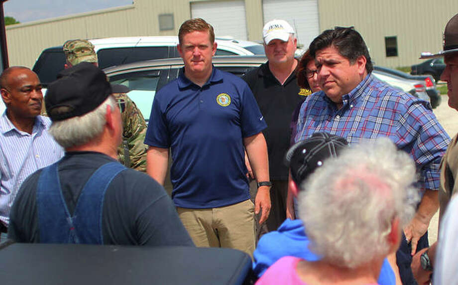 "Gov. J.B. Pritzker listens to Paul T. ""Snow"" Herkert of Calhoun County before a meeting at the State Unified Area Command in Winchester Tuesday. Pritzker held a press conference before touring the river flooding by helicopter. Photo: Rosalind Essig 