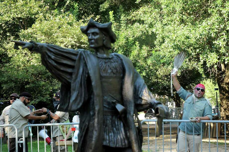 A protester speaks near a statue of Christopher Columbus during a protest and march to recognize Indigenous Peoples day at Bell Park in Houston in 2017. Photo: File Photo / Dave Rossman