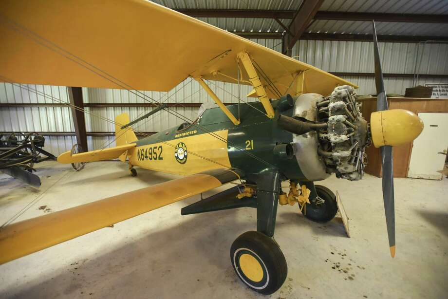 "A 200 horsepower Continental Stearman bi-plane flown by M&M Air Service at the Winnie's Agricultural Historical Museum.  On April 9, 1946 K.W. ""Kinky"" Shane flew the plane along with its 700-pound hopper over a 90-acre field dropping seeds from the plane as it flew over.  This flight was the first time that seeding rice by air took place in Texas and went on to change the Coastal rice growing industry. The ability to get a head start on weeds, seed their crop at the proper time and fertilize on demand gave rice an importance approaching cotton in the region.  The plane could not only seed but also contained nozzles that allowed for spraying of fertilizer from the same plane.  Photo taken on Tuesday, 03/26/19. Ryan Welch/The Enterprise Photo: Ryan Welch / Ryan Welch / The Enterprise / ©Ryan Welch"