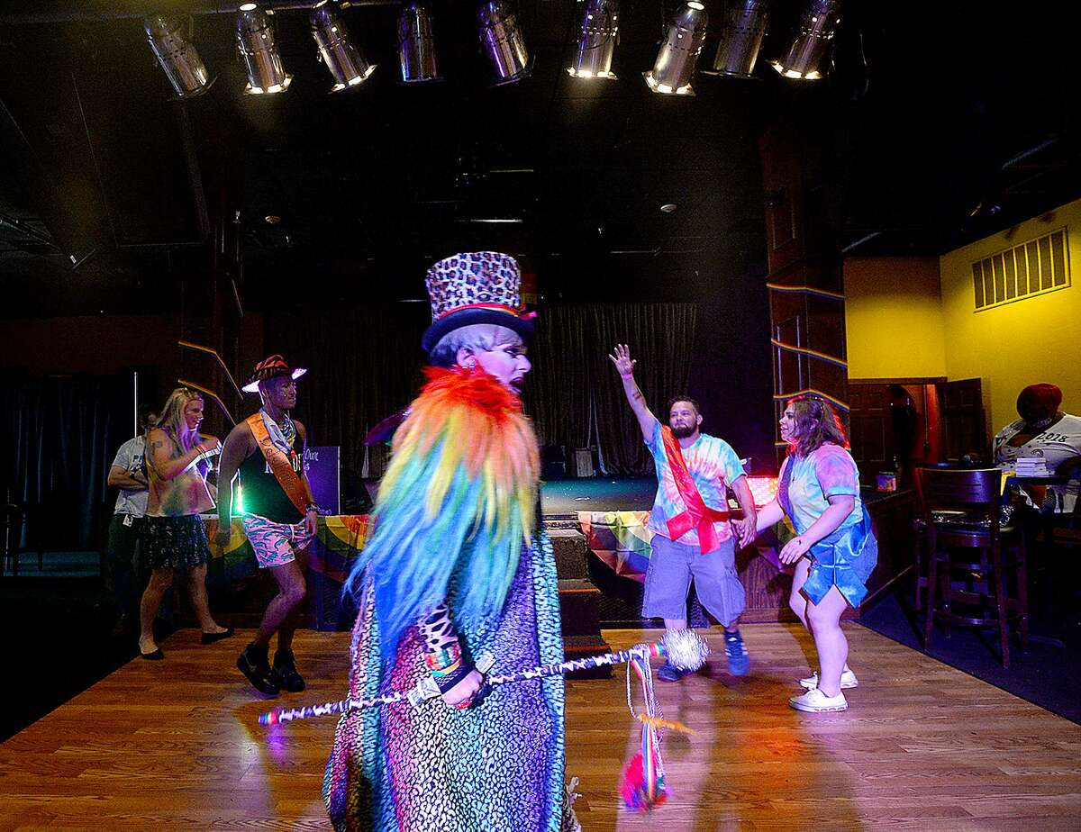 Debutantes dance after their introduction in The Red Room at Pride Fest 2018. The annual event, hosted by PFLAG Beaumont, kicked off with an Equality March to the Crockett Street Entertainment Complex. Food trucks, vendors, information booths, performance artists, music and drag shows indoors and out rounded out the activities to celebrate equality, diversity and LGBT pride. Photo taken Saturday, June 9, 2018 Kim Brent/The Enterprise