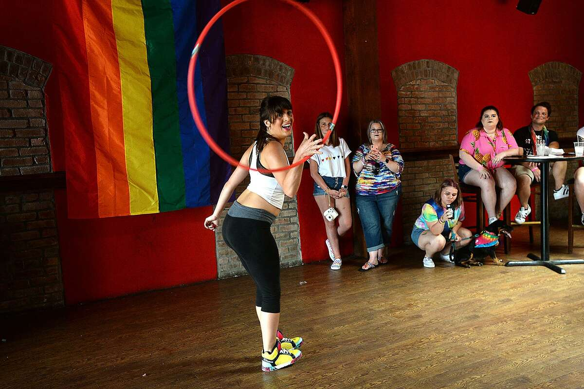 Hula hooper Krista Hollier performs in The Red Room at Pride Fest 2018. The annual event, hosted by PFLAG Beaumont, kicked off with an Equality March to the Crockett Street Entertainment Complex. Food trucks, vendors, information booths, performance artists, music and drag shows indoors and out rounded out the activities to celebrate equality, diversity and LGBT pride. Photo taken Saturday, June 9, 2018 Kim Brent/The Enterprise