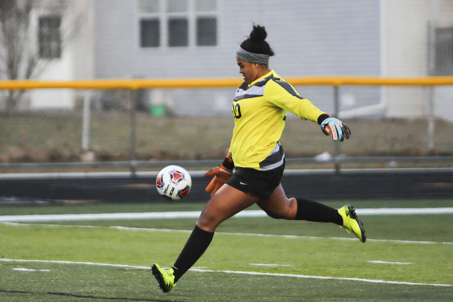 Midland High goalie Maya Etienne, shown in a game earlier this season, made three saves during a shootout to key the Chemics' victory over Portage Central in a Division 1 soccer regional semifinal on Tuesday.