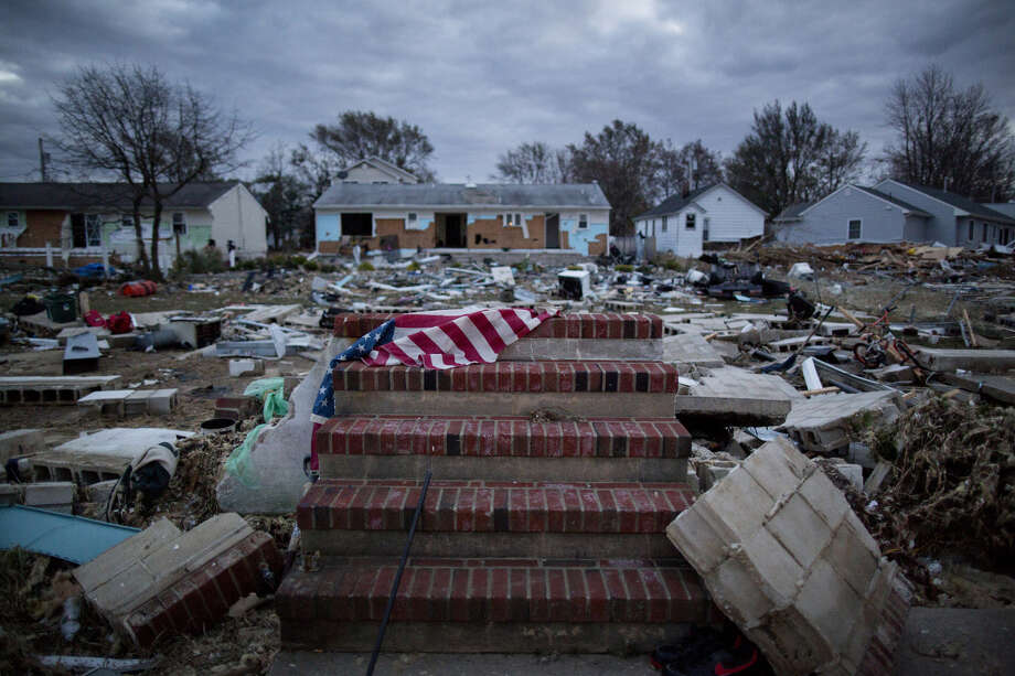 Debris covers the front steps of a home destroyed during Hurricane Sandy in Union Beach, N.J., on Nov. 3, 2012. Photo: Bloomberg Photo By Victor J. Blue. / © 2012 Bloomberg Finance LP