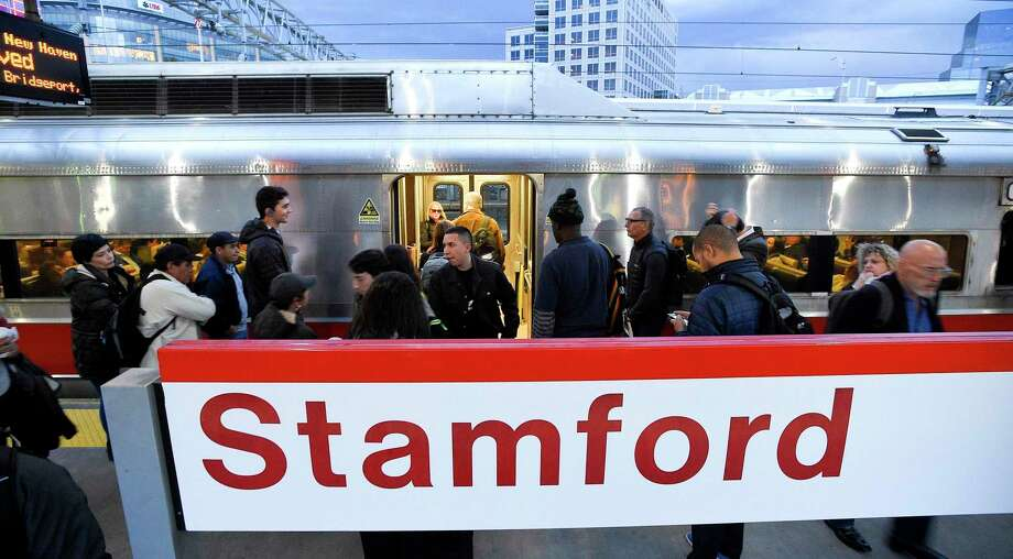 Commuters exit a Metro-North train at the Stamford train station. Photo: Matthew Brown / Hearst Connecticut Media / Stamford Advocate