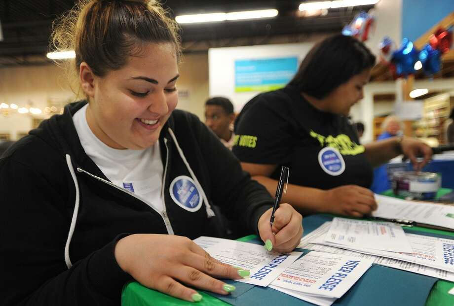 Julissa Santiago, left, and Tiana Krause, both of Bridgeport, fill out voter pledge cards during a National Voter Registration Day event at the Habitat for Humanity ReStore in Stratford on  Sept. 25, 2018. Fairfield County's Community Foundation's Get Out the Vote Program has awarded 18 grants to civic-minded organizations to energize and educate the community to vote. Photo: Brian A. Pounds / Hearst Connecticut Media File Photo / Connecticut Post