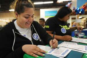 Julissa Santiago, left, and Tiana Krause, both of Bridgeport, fill out voter pledge cards during a National Voter Registration Day event at the Habitat for Humanity ReStore in Stratford on  Sept. 25, 2018. Fairfield County's Community Foundation's Get Out the Vote Program has awarded 18 grants to civic-minded organizations to energize and educate the community to vote.
