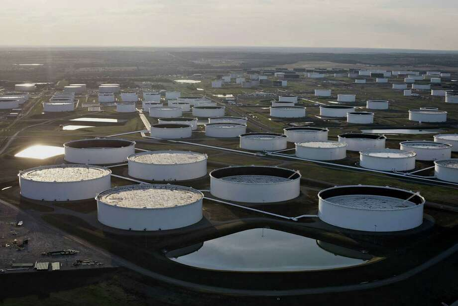 Oil storage tanks stand in this aerial photograph in Cushing, Okla. Photo: Bloomberg Photo By Daniel Acker / Bloomberg