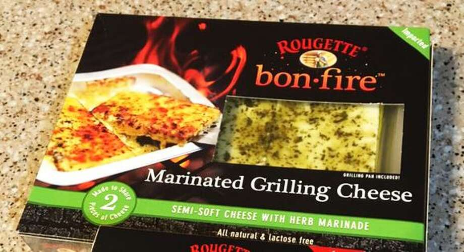 An assortment of Rougette Bonfire grilling cheeses, which are available at area H-E-B stores for $7.98 per package. Photo: Chuck Blount / Staff