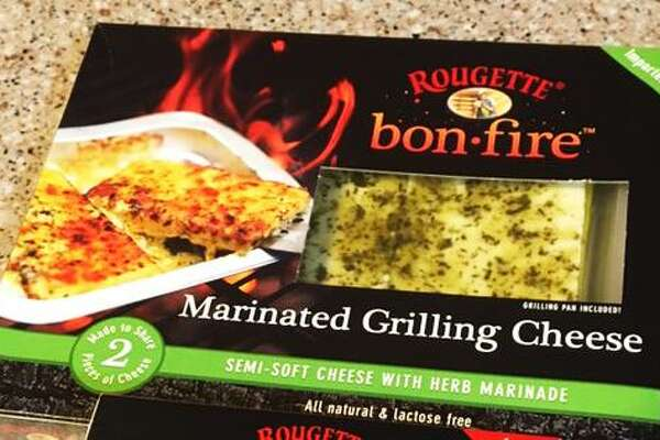 An assortment of Rougette Bonfire grilling cheeses, which are available at area H-E-B stores for $7.98 per package.
