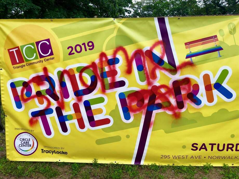 """A banner advertising the """"Pride in the Park"""" event, scheduled for Saturday, June 8, 2019was vandalized. Members of the Triangle Community Center removed the banner on Wednesday, June 5, 2019. Photo: Courtesy Of The Triangle Community Center"""